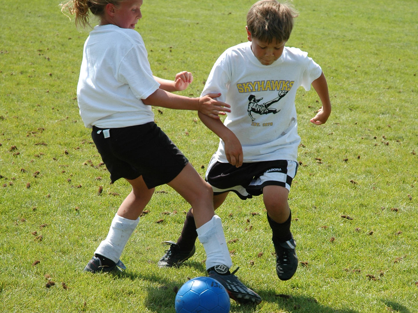 Boy and Girl Playing Soccer